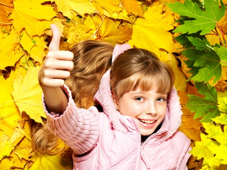 Child in autumn orange leaves. Outdoor. Stock Photo - 10701656