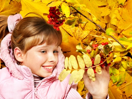 Child in autumn orange leaves. Outdoor. Stock Photo - 10701700