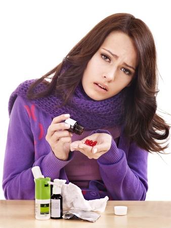 diseased: Young woman having flu takes pills.