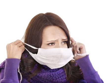 tonsillitis: Sick young woman in medical mask.