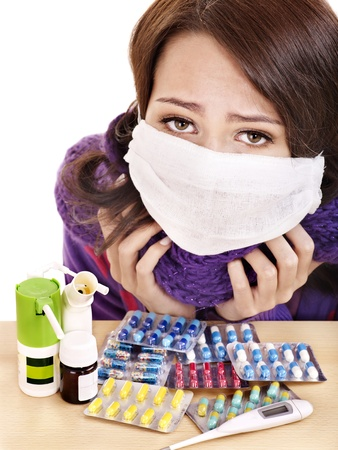 Young woman having flu takes pills. photo