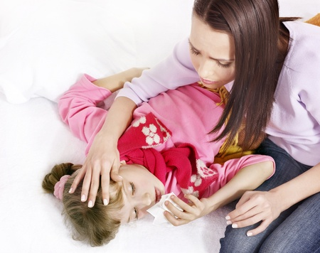 sniffle: Sick little girl with mother. Isolated. Stock Photo