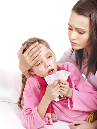 sick in bed: Sick little girl with mother. Isolated. Stock Photo