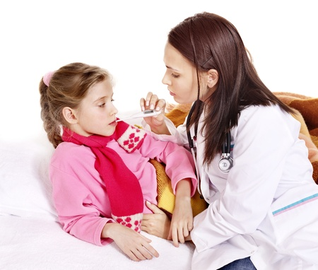 Doctor checking temperature of child. photo