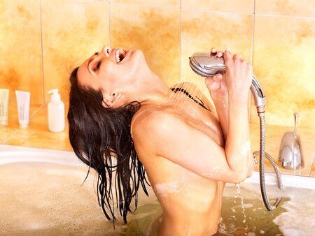 Young woman take bubble  bath. photo