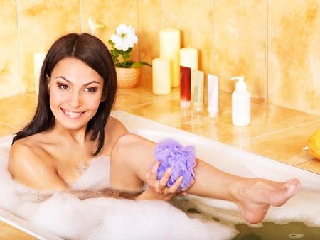 bath sponge: Young woman take bubble  bath.