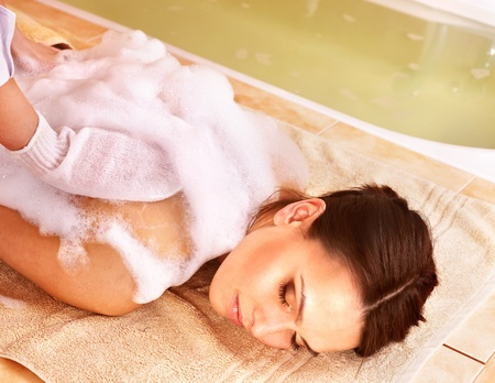 steam room: Young woman in hammam or turkish bath. Stock Photo