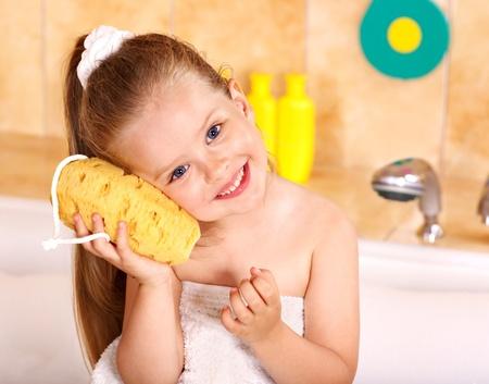 bath room: Child washing in bubble bath . Stock Photo