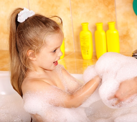 Child washing in bubble bath . Stock Photo - 10701842