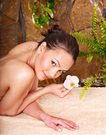parlour: Beautiful young woman getting massage in spa. Stock Photo