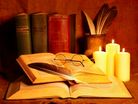 Stack old book and candle. Education. Stock Photo