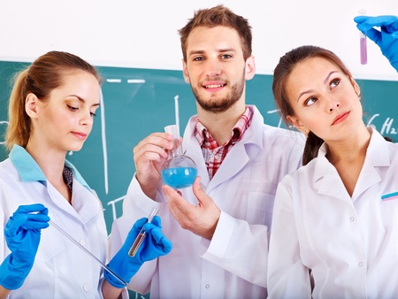 Group chemistry student with flask in classroom. photo