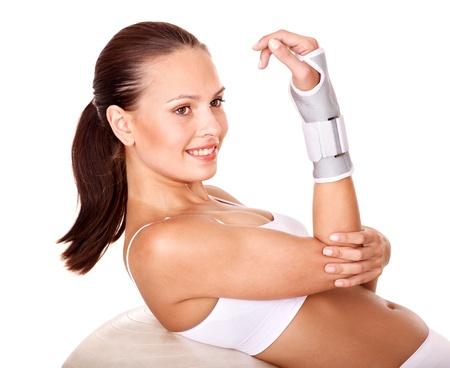 splint: Mujer con llave de muñeca. Aislado. Foto de archivo