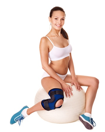 aerobic treatment: Woman with knee brace. Isolated.