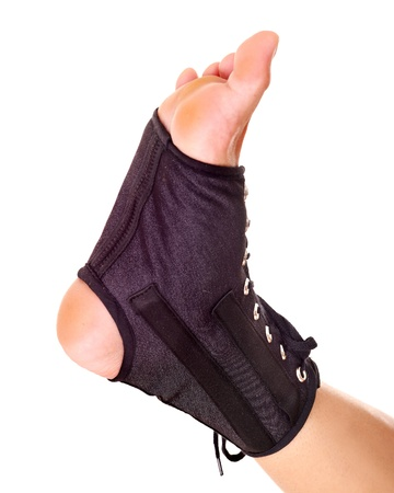 Trauma of ankle in brace. Isolated. Stock Photo - 10701447