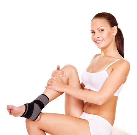 ankle: Woman with ankle brace. Isolated. Stock Photo