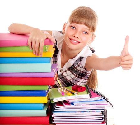 Schoolgirl with stack of books and showing thumb up. Isolated.