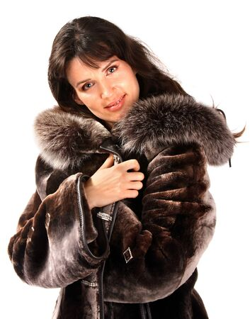 Woman in fur coat. Isolated. photo