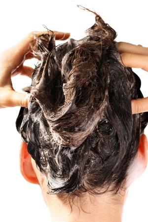 soap sud: Woman washing hair by shampoo .