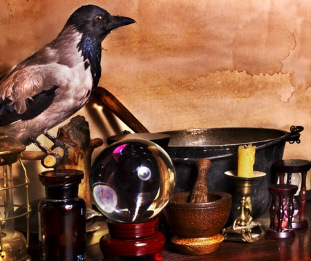 raven: Halloween still life with candle. Vintage.
