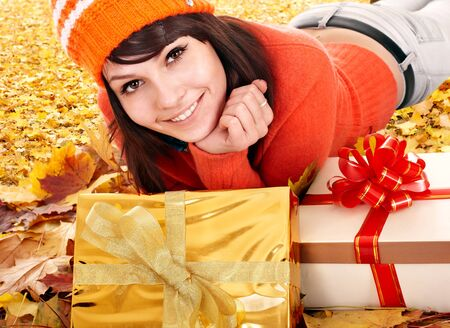 Girl in autumn outdoor holding gift box. Holiday. Stock Photo - 10778674