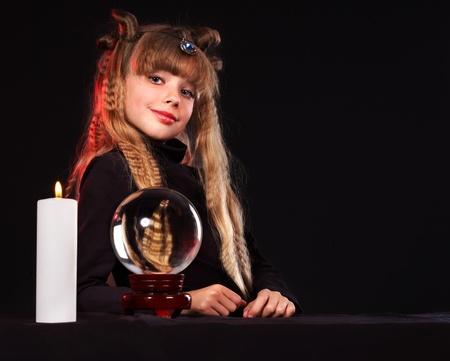 foretell: Little girl holding crystal ball.Series.