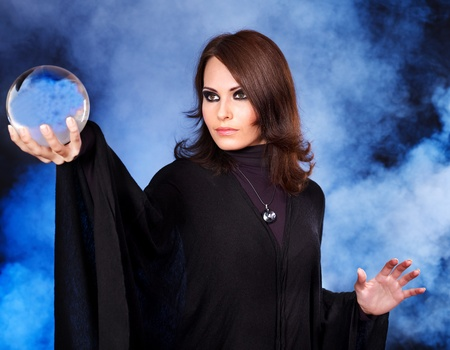guess: Young beautiful woman with crystal ball. Stock Photo