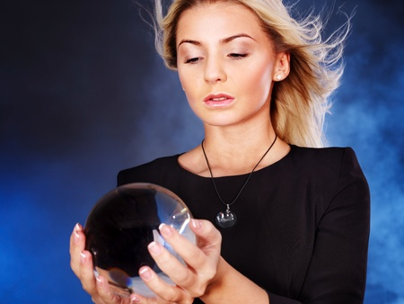 clairvoyance: Young beautiful woman with crystal ball. Stock Photo