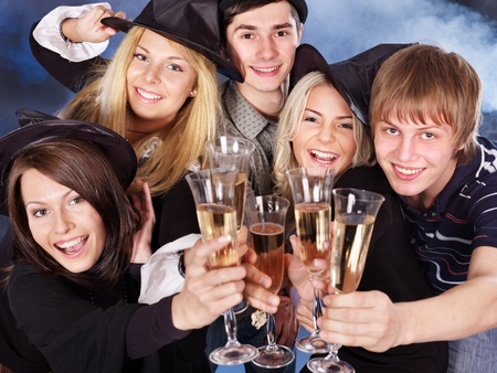 Group young people drinking champagne at nightclub. photo