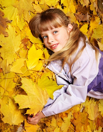 Child in autumn orange leaves. Outdoor. Stock Photo - 10778765