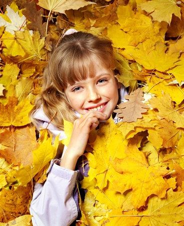 Child in autumn orange leaves. Outdoor. Stock Photo - 10778767