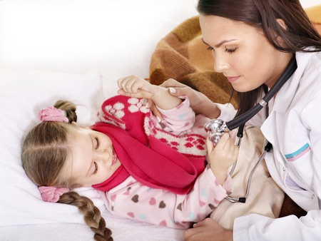 Doctor exams  little girl with stethoscope. Isolated. photo