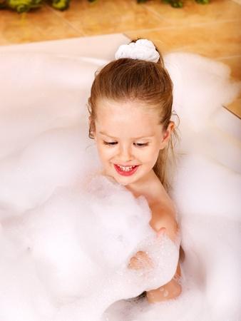 bath sponge: Child washing in bubble bath . Stock Photo