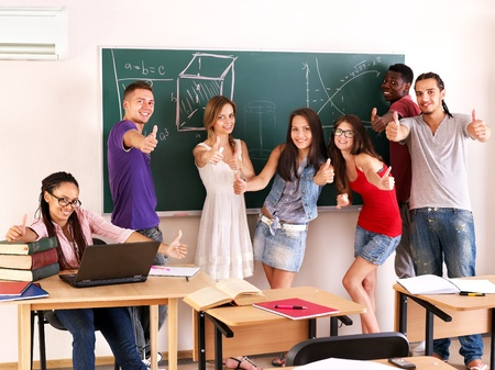 Group student in classroom near blackboard. Stock Photo - 10778721