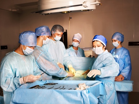 Group of surgeon looking at patient in operation room. photo