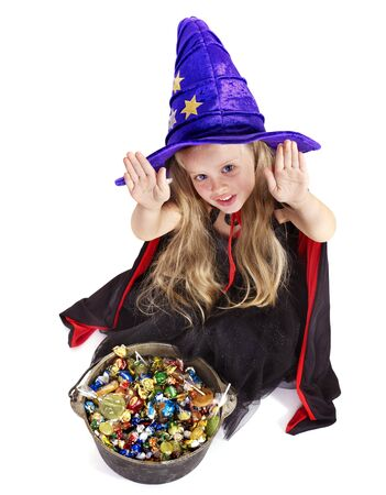 caldron: Witch  little girl with candy. Halloween.