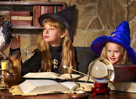 divining: Witch  children with crystal ball. Halloween.
