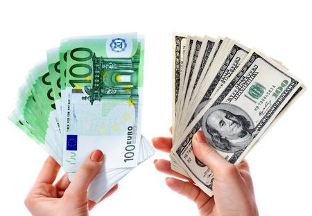 Exchange dollars to euro money in female hand. Concept. photo