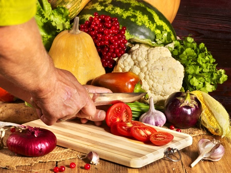 Preparing fresh vegetable on wooden boards. photo