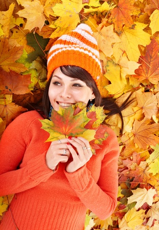 Young woman in autumn orange leaves. Outdoor. Stock Photo - 10853242