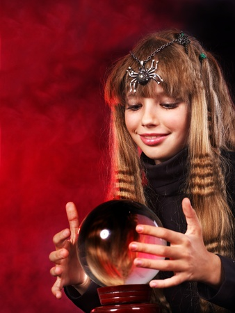 Little girl holding crystal ball. Fortune telling. Stock Photo - 10852951