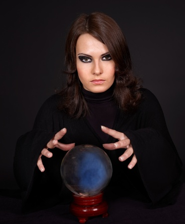 telling: Young beautiful woman with crystal ball. Stock Photo