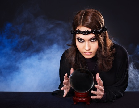 guess: Young woman with crystal ball. Fortune telling.