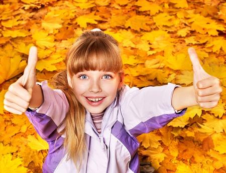 Child in autumn orange leaves. Outdoor. Stock Photo - 10853248