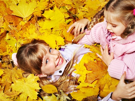 Child in autumn orange leaves. Outdoor. Stock Photo - 10853310
