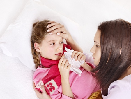 Sick little girl with mother. Isolated. photo