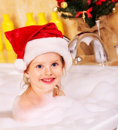 Child washing in bubble bath . Stock Photo