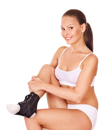 aerobic treatment: Woman with ankle brace. Isolated. Stock Photo