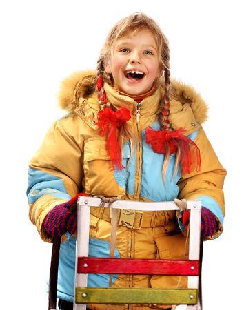 Little girl holding sleigh on white. photo