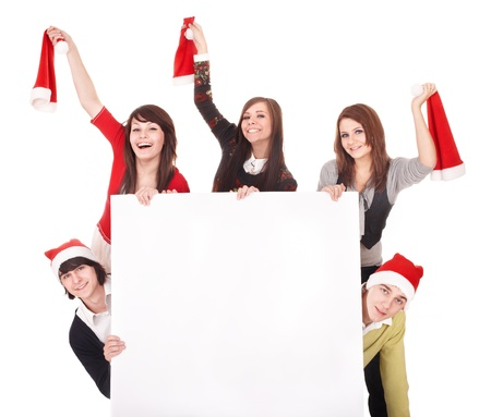 Happy group  people  in santa hat whith banner. Isolated. photo